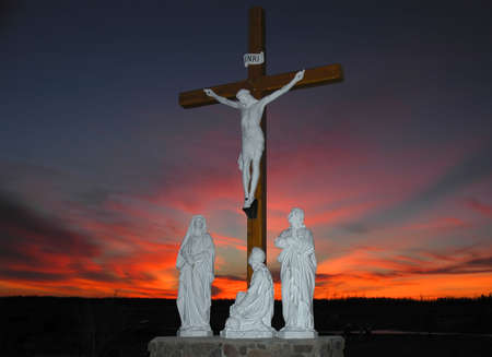 Crucifixion scene in front of colorfull sunset