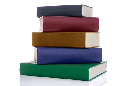 A stack of five hardback reference books with blank spines isolated on a white background.