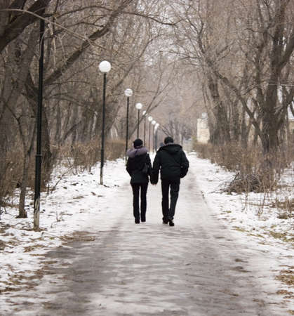 a couple walking in park