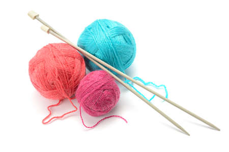 Woolen balls and knitting needles isolated on white