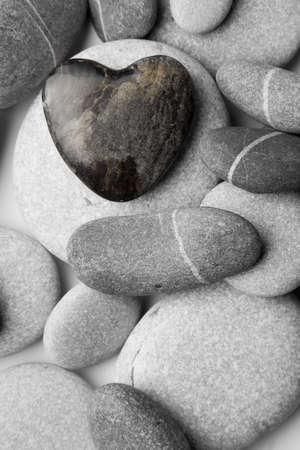 A single heart shaped pebble on a nice shingle beach