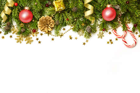 Christmas tree branches with red baubles,  golden stars, snowflakes isolated on white  -  horizontal border