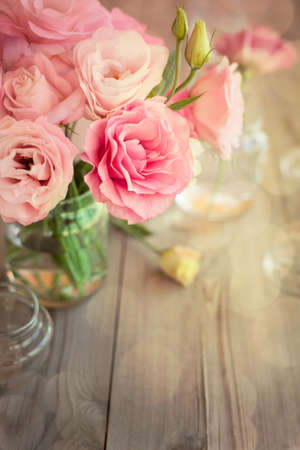 Bright romantic background with roses and bokeh, copy space for text