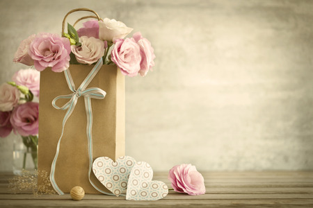 Wedding background with pink roses bow and paper Hearts vintage style