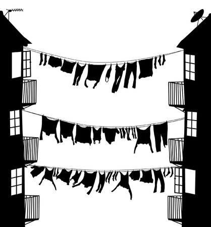 Editable vector silhouette of washing hanging between houses in an alley
