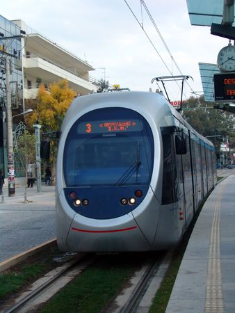 A front view of a tram in the city of Athens
