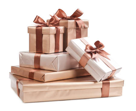 boxes with gifts and brown bows isolated on white background