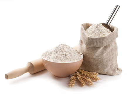 kitchen utensils, ears, flour in a bowl and bag isolated.