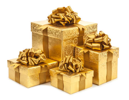Gift boxes of gold color isolated on white background.