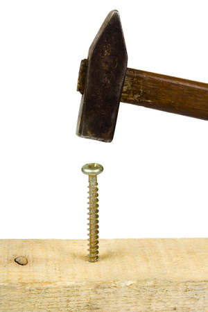 Hammer and screw, isolated on white background