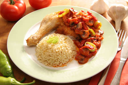 Fried chicken with souse made of tomatoes, mushrooms, peppe, garlic and sausage.