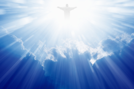 Bright light of Jesus Christ in blue sky with clouds