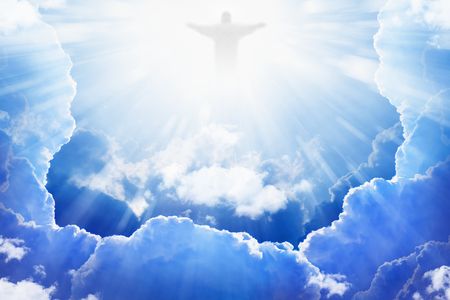 Photo for Jesus Christ in blue sky with clouds, bright light from heaven, resurrection, easter - Royalty Free Image