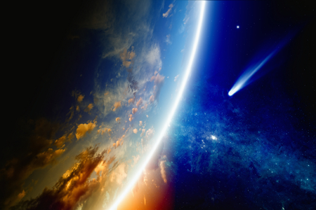 Abstract scientific background - comet approaches glowing planet Earth, nebula and stars in space