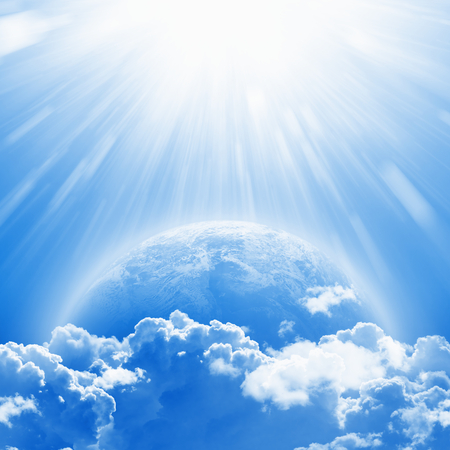 April 22 International Mother Earth Day, blue planet Earth in white clouds, bright sunlight from above.