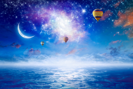 Photo pour Tranquil heavenly picture - colorful hot air balloons flying in blue starry sky with bright stars, new moon and twisted galaxy - image libre de droit