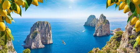 Photo pour Welcome to Capri concept. Panoramic collage with different view of Faraglioni Rocks near Capri Island, Italy. Beautiful paradise landscape with azure sea in summer sunny day and ripe yellow lemons. - image libre de droit