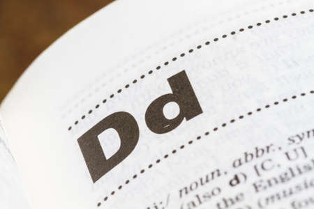 closeup letter D in dictionary, soft focus,