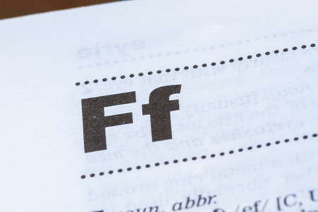 closeup letter F in dictionary, soft focus,