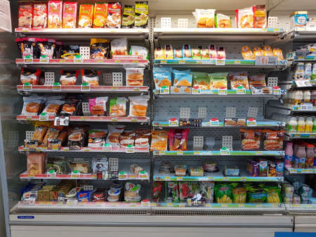 CHIANG RAI, THAILAND - NOVEMBER 26: various brand of frozen foods in packaging for sale on supermarket stand or shelf in Seven Eleven on November 26, 2016 in Chiang rai, Thailand