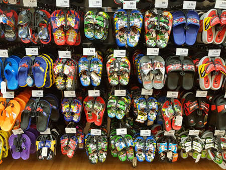 CHIANG RAI, THAILAND - FEBRUARY 6: various brand of toe post sandals for sale on supermarket stand or shelf on February 6, 2017 in Chiang rai, Thailand.