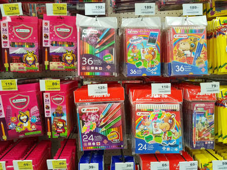 CHIANG RAI, THAILAND - FEBRUARY 15 : various brand of crayon in packaging for sale on supermarket stand or shelf on February 15, 2017 in Chiang rai, Thailand.