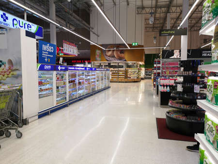 Photo pour CHIANG RAI, THAILAND - MARCH 7, 2019 : Perspective view of aisle in supermarket with products on shelf on March 7, 2019 in Chiang rai, Thailand. - image libre de droit