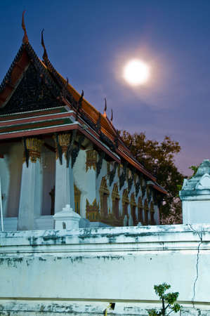 A Wat during night with full moon in the sky. Ayutthaya city is the capital of Ayutthaya province in Thailand.
