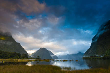 Cloudy morning at milford sound with sunrise in the back ground