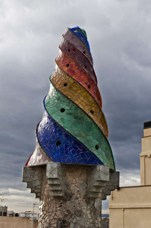 BARCELONA, SPAIN - DECEMBER 15  The mosaic chimneys made of broken ceramic tiles on roof of Palau Guell , one of the earliest Gaudi