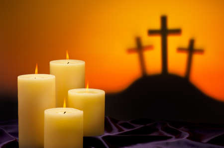 Three crosses symbolic for Jesus crucifixion in Golgotha and candles of hope