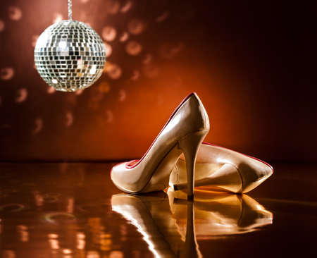 Beautiful brown stilettos on the dance floor with mirror ball