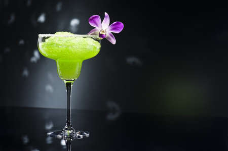 Green margarita cocktail with orchid flower