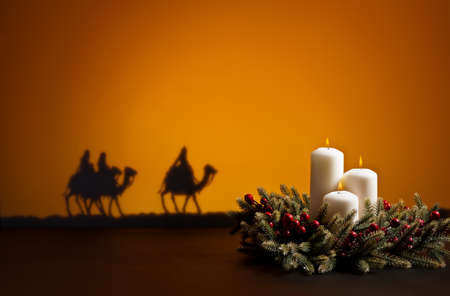 Three wise men on the way to Jesus in Bethlehem and candles