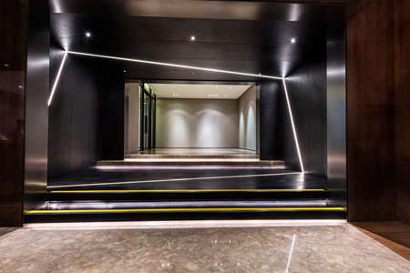 Illuminated and empty foyer entrance area of a building