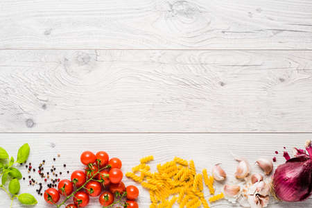 Photo for Italian cooking ingredients on a old rustic wooden table - Royalty Free Image