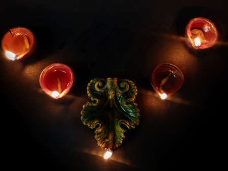 Photo for Home decoration using oil lamp or diya arranged in row for Diwali celebrations , selective focus on deep , black background - Royalty Free Image