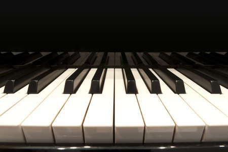 white and black keys of concert grand piano