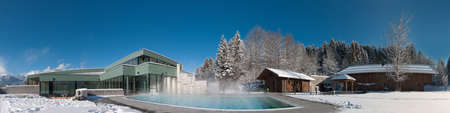 panorama of a modern swimming pool and sauna area at a wonderful winters day