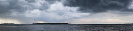 panorama of dramatic mood before storm at lake chiemseeの写真素材