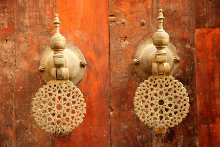 Traditional door handles to the home in the Fes medina, Morocco