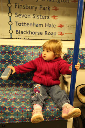 Little girl sitting inside the train on the London railway