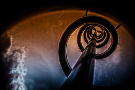 Abstract industrial background of toned detail of a metallic spiral