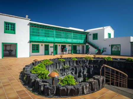 Lanzarote, Spain -  August 22, 2016: Tourists on the courtyard of the Cesar Marique Foundation in Tahiche, Lanzarote, Canary Islands, Spain