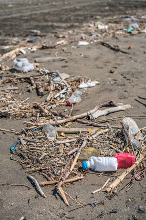 Large amounts of of the sea washed up rubbish, garbage and plastic bottles on the shore of once beautiful Velika Plaza near Ulcinj, Montenegro