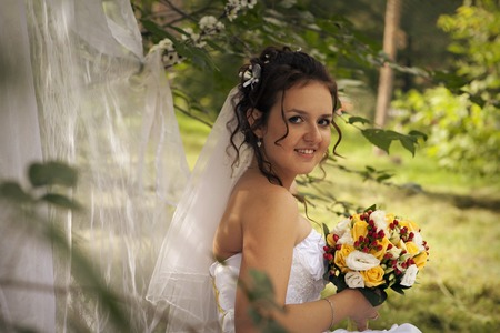 Foto de girl with a bouquet of flowers. Bride sniffing bouquet - Imagen libre de derechos