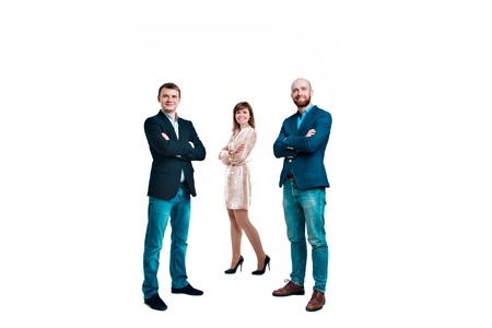Photo pour Business development concept: three people looking forward on a white background. Three attractive business people in suits stand next to each other all facing forward - image libre de droit