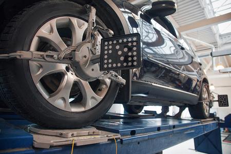 Photo pour car repair: wheel replacement closeup. mechanic screwing or unscrewing car wheel at car service garage - image libre de droit