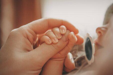 Photo pour Babys hand, fingers close up. newborn baby arms, massage concept of childhood, health care, IVF, hygiene - image libre de droit