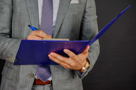 Photo pour Writing on clipboard - image libre de droit